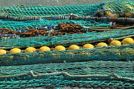 buoys: Fishing nets in the port of Loctudy, Finistere, Brittany, France spread to dry