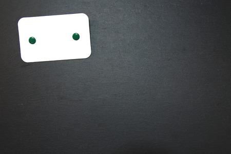 Blackboard (slate) with blank, writable notepad Stock Photo