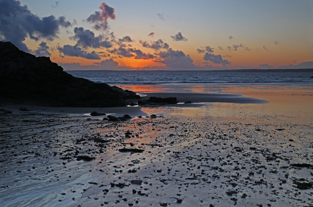 Sunset on Trez Rouz beach at Camaret-sur-Mer, Crozon peninsula, Finistere, Brittany, France