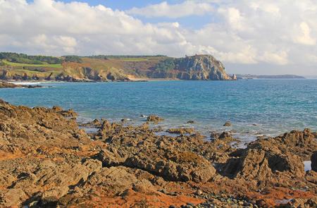 rocky coast at the Atlantic Ocean, Ile de lAber, Crozon peninsula, Finistere, Brittany, France Stock Photo