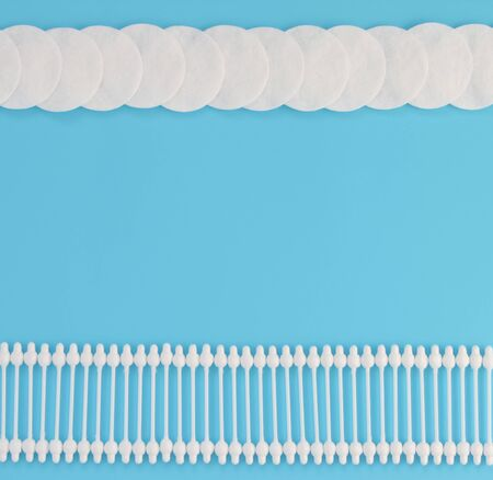 Pattern of cotton swabs and cotton pad. Flat lay minimal concept. Top view. Stylized photo.