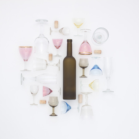 Pattern of the bottles, glasses and bung. Flat lay concept. Top view.