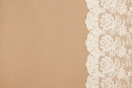 Vintage lace on a cardboard background. Packaging. Boho style.