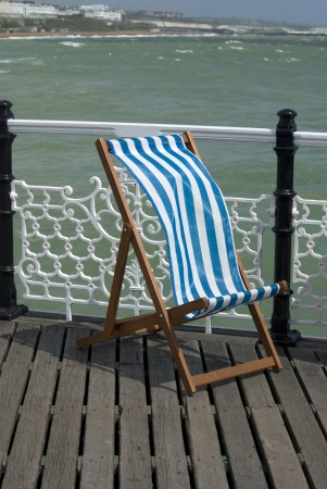 deckchair on a windy day - photo taken on Brighton Pier UK  photo