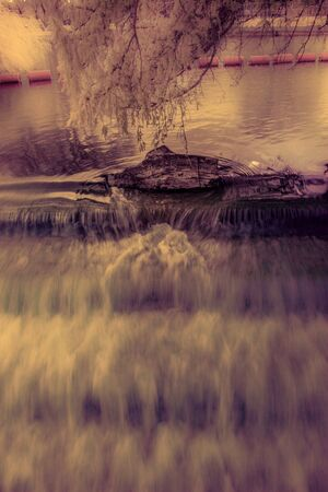 weir: Infrared river photography - Log in the weir photo taken in Bedford UK