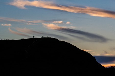 sillhouette: Landscape photo of a sillhouette man enjoying the evening view from the top of a hill near Sherringham