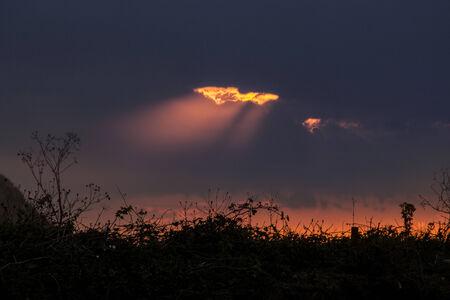 orange sunset: Pretty orange sunset through the clouds.