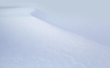 Abstract photo of the pattern in white snow.