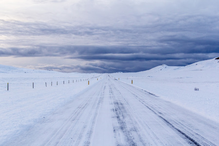 Photo of a road that is covered in snow in Iceland Stock Photo