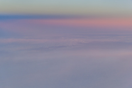 Abstract cloudscape at sunset photographed from above the clouds in an aeroplane