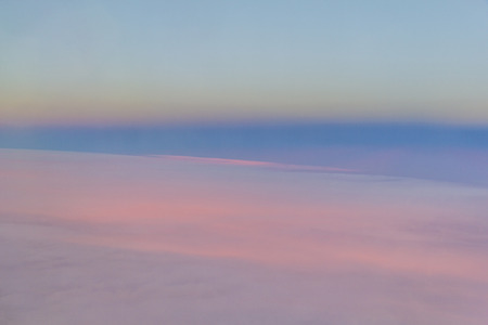 Abstract sunset in the sky - taken from above the clouds in an aeroplane Stock Photo