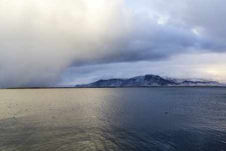 Weather bomb storm and mountainscape  landscape with water in Reykjav?k, Iceland.