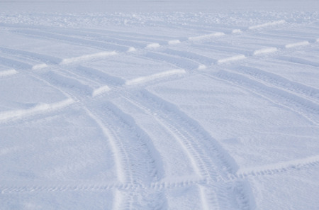 Abstract photo of tyre tracks in snow. Photo taken in Iceland