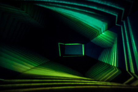 Abstract Light Painting Photography of green lights in a box.