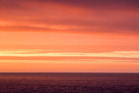 Abstract photography of an orange and purple sunset above the sea  ocean.