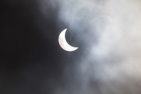 Photo through the clouds of the solar eclipse from Cambridgeshire in the UK