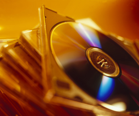 jewel case: Close up of a stack of DVDs with orange gel lighting Stock Photo