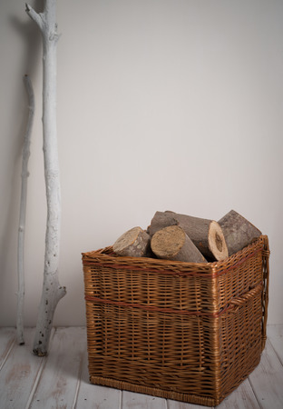 log basket: Logs In Wicker Basket with a white stick