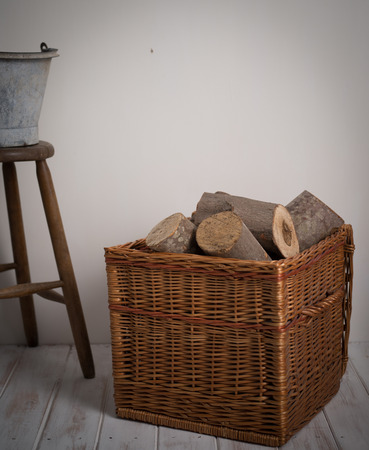 log basket: Logs In Wicker Basket with a stool and metal bucket