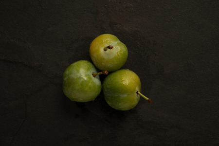 arranged: Trio of arranged greengages.