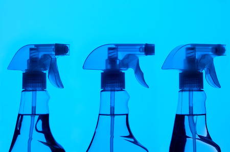 Three spray bottles on blue back ground looking like an x-ray Stock Photo