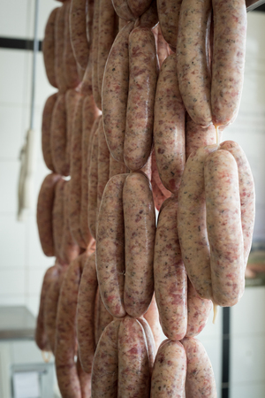 hanging up: Pork sausages in a string hanging up Stock Photo