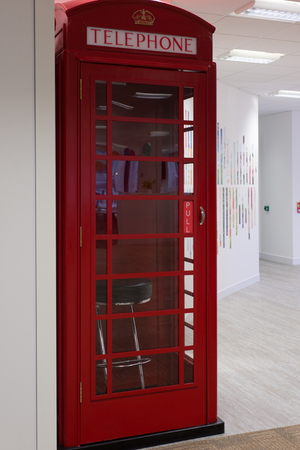 telephone box: Iconic British telephone box in an office building.