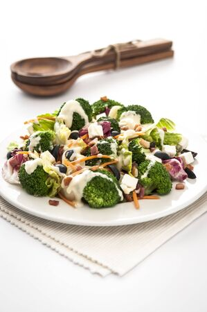 brocoli: Brocoli and feta salad with dressing isolated on white