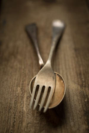 panelling: Vintage rustic cutlery,fork,spoon, on wooden panelling background.