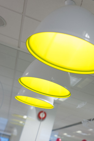 office environment: Trio of pendant lamps in an office environment.