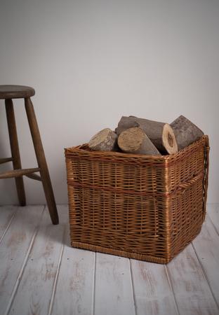 log basket: Logs In Wicker Basket with stool