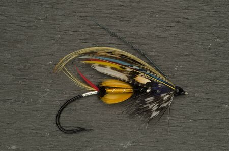 jock: Traditionally dressed Jock Scott salmon fly shot against a slate background