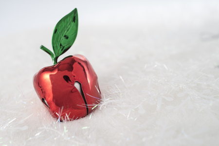 apple christmas: Red apple christmas decoration on a snowy background