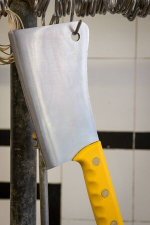 cleaver: butchers meat cleaver hanging up in butcherhouse Stock Photo
