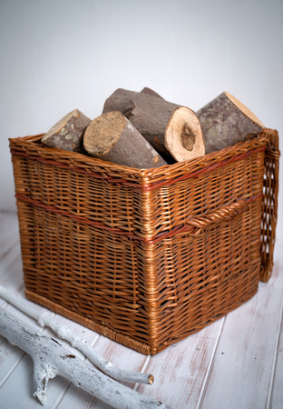 log basket: Logs In Wicker Basket closer up with white stick