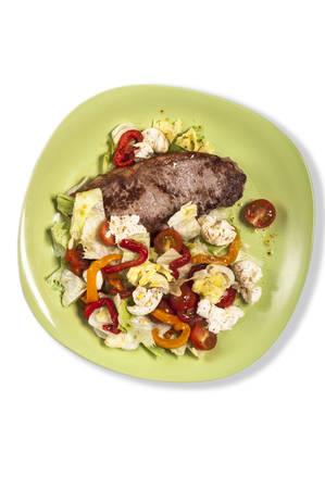 rump steak: Rump steak with a tomato and mozzarella sald