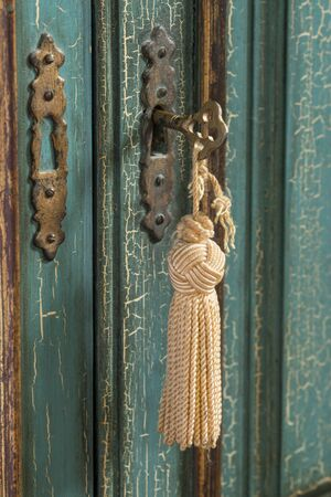 craquelure: Close up of an old key in cupoard lock Stock Photo