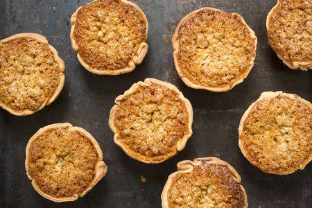 treacle: Treacle tarts on a baking tray shot from overhead