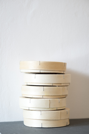 lactic: A stack of St Jude cheese boxes on slate against a white wall