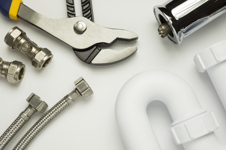 s trap: A selection of plumbing tools and fittings on a white background