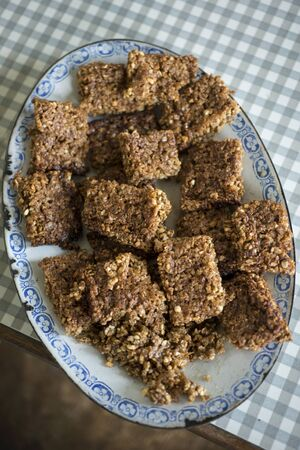 flapjacks: A plate of freshly baked flapjacks on a vintage plate Stock Photo