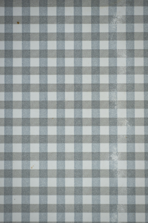 formica: Close up of a gingham check formica vintage table top