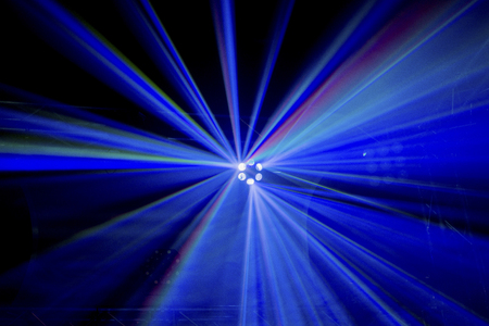 light beams: Multicoloured light beams from a high up disco stage light