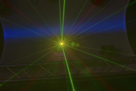 staging: Light rays from a high up disco light in a nightclub with staging below