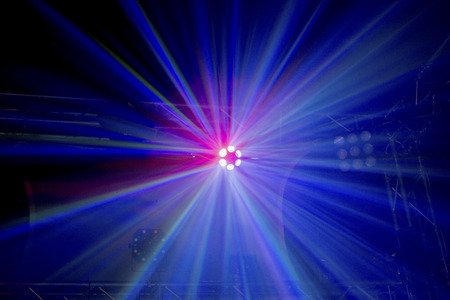 high up: Multicoloured light beams from a high up disco stage light
