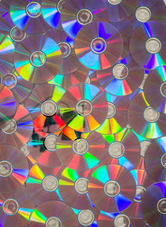 dozens: Dozens of CDs or DVDs laid flat for abstract or backgrounds.