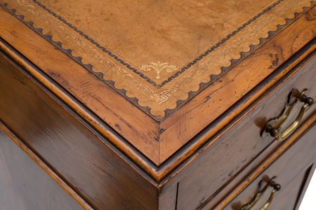 antique table: Overhead of a corner of an antique wooden office table Stock Photo