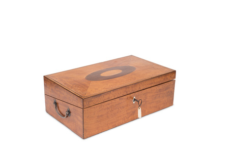 key box: Cut-out of a closed wooden vanity box with key in lock