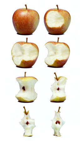 varying: A row of apples depicting varying stages of being eaten from whole apple to core on a white background