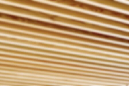 joist: Blurred or defocused close up of wooden joist ceiling of commercial building